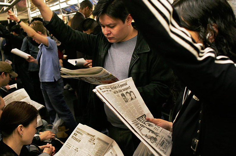 People reading newspapers